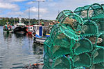 Photo of fishing boats and lobster traps pixabay Richard442